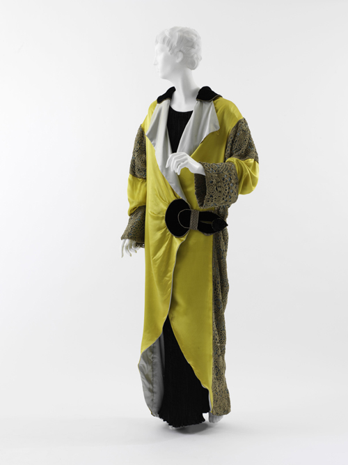 Paul Poiret (French, 1879–1944). Opera Coat, 1912. Yellow and pale blue silk satin, black silk velvet, turquoise silk satin with gold and silver filé crocheted overlay, and silver filé trapunto half-belt and trim. The Metropolitan Museum of Art, Purchase, Irene Lewisohn Bequest, 1982