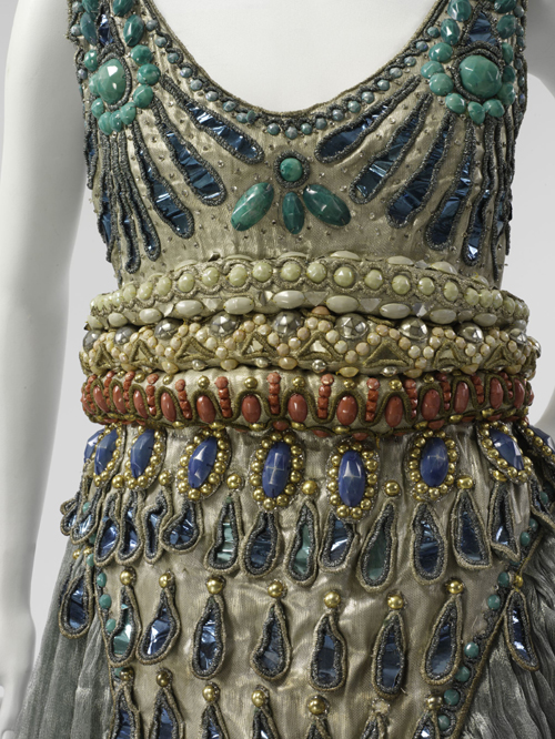 Paul Poiret (French, 1879-1944). Fancy Dress Costume, 1911. Seafoam green silk gauze, silver lamé, blue foil and blue and silver coiled cellophane cord appliqué, and blue, silver, coral, pink, and turquoise cellulose beading. The Metropolitan Museum of Art, Purchase, Irene Lewisohn Bequest, 1983