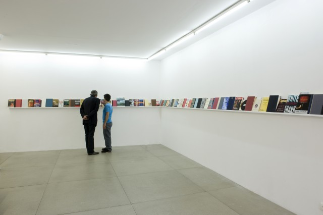 Julien Prévieux, Forget the Money, 2011. Bernard Madoff's books, inkjet prints and sound (voice: Charlie Jeffery), variable dimensions. Courtesy Galerie Jousse Entreprise, Paris. Photograph © Marc Domage.