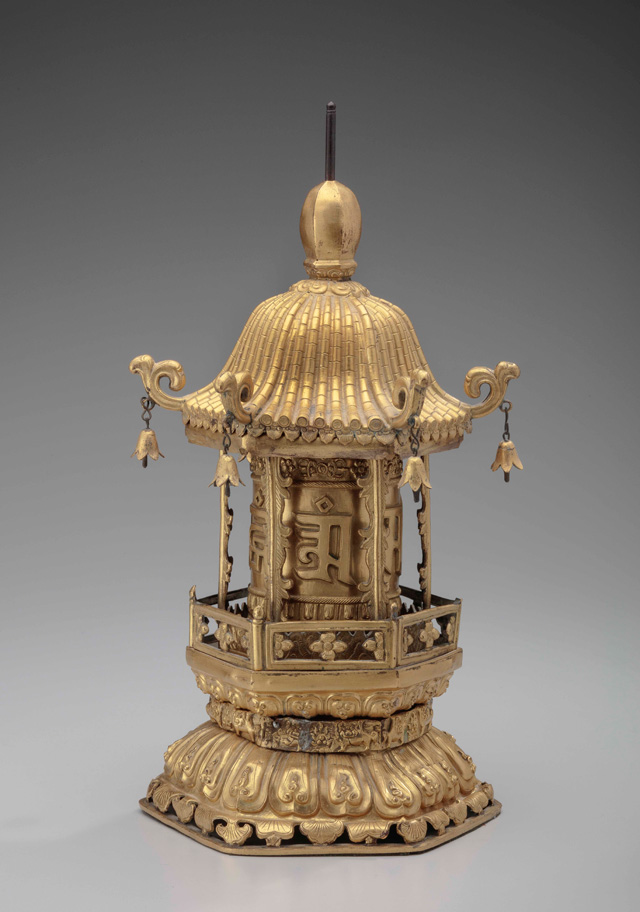 Table-top prayer wheel (mani 'khor lo), Tibet, 19th or early 20th century. Gilded copper-alloy, paper, ink. Newark Museum; Newark Museum Bequest of Edward N. Lippincott. Photo © The Newark Museum.