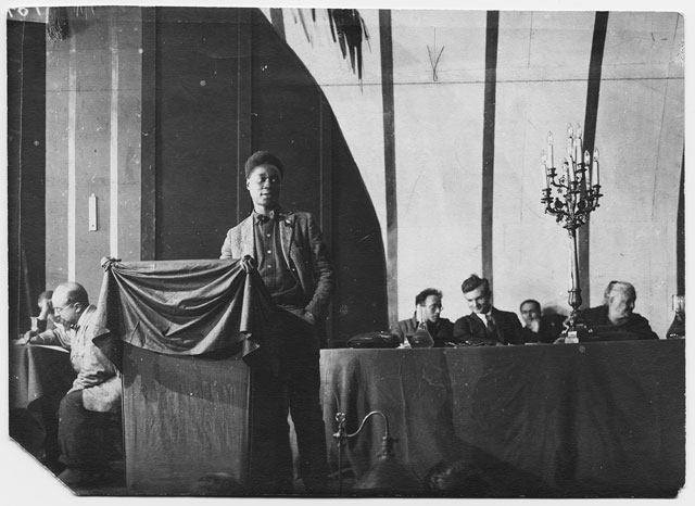 Photograph of Claude McKay addressing the Third Congress of the Communist International at the Throne Room of the Kremlin, Moscow, 1922 (reprint 2017). Courtesy of Clause McKay Collection, Yale Collection of American literature, Beinike Rare Book and Manuscript Library.