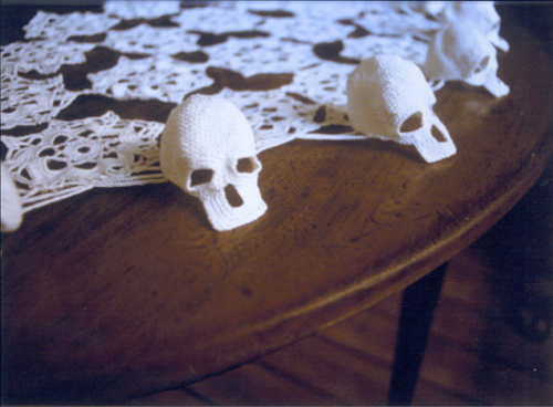 Hildur Bjarnadóttir, <em>Untitled (Skulls)</em>, 1999 (detail). 4 x 54 x 54 in. (5 x 136 x 136 cm.). Crocheted cotton yarn, wood table. Collection of the artist