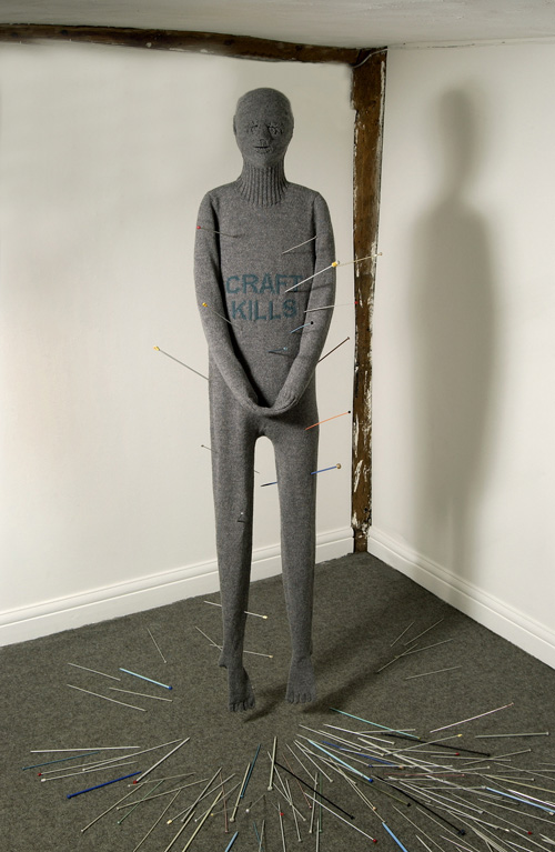 Freddie Robins, <em>Craft Kills</em> (detail), 2002. Machine-knitted wool, knitting needles full installation: 8 ½ ft. x 27 in. x 15 in. Photo: Douglas Atfield