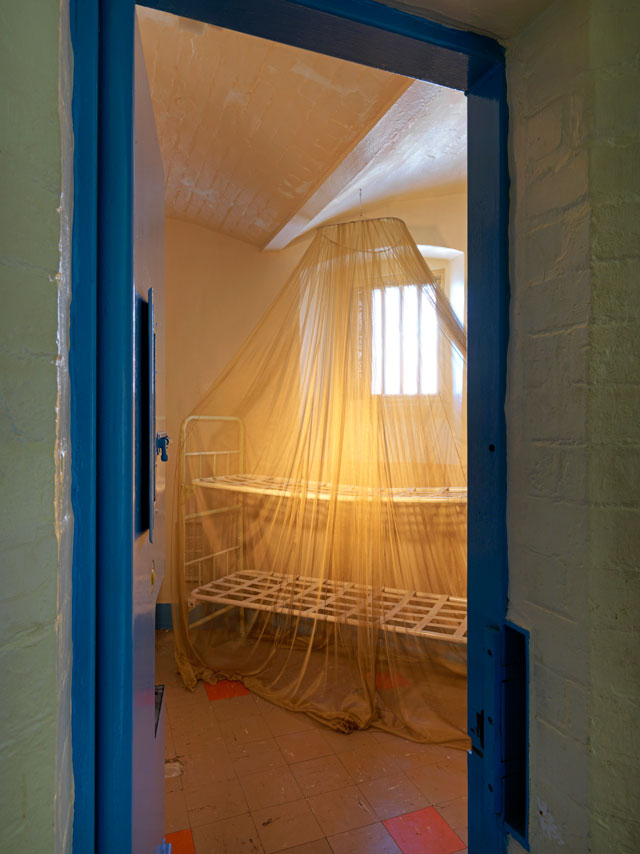 Steve McQueen, The Weight, 2016. Gold-plated mosquito net draped over a prison-issue bunkbed. Photograph: © Marcus J. Leith. Courtesy of Artangel.