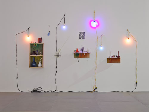 Elias Hansen. Love really had a way of letting us lose ourselves, 2014. Found objects, glass, light bulbs, naked lady cards, photograph, steel, wire, and wood, approx 270 x 410 x 40 cm (106¼ x 161⅜ x 15¾ in). Image courtesy of the artist and Blain|Southern. Photograph: Peter Mallet. © the artist.