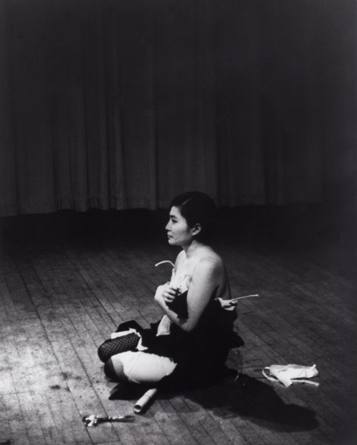Yoko Ono. Cut Piece, 1964. Performed by the artist, 21 March 1965. Carnegie Recital Hall, New York City. Film still from Maysles Brothers. © Yoko Ono.