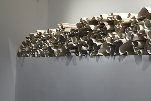 Carol Young (b1952). Memoria (Memory), 2013. Ceramic installation of 130 elements. Courtesy of the artist.