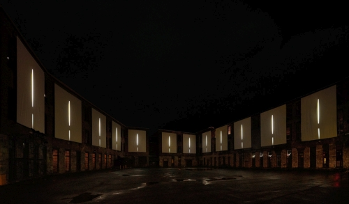 Clifford Ross. Nighttime view of immersive Harmonium Mountain video. Courtyard D. MASS MoCA.