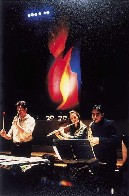 Mark Rowan-Hull. <i> Performance with complementary lighting.          Paintings inspired by Messe de la Pentec&ocirc;te by Olivier Messiaen</i>. Royal Festival Hall 2002<i>.</i>