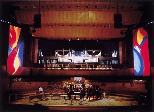 Mark Rowan-Hull. <i>Performance with complementary lighting.          Paintings inspired by Messe de la Pentec&ocirc;te by Olivier Messiaen</i>. Royal Festival Hall 2002<i>.</i>