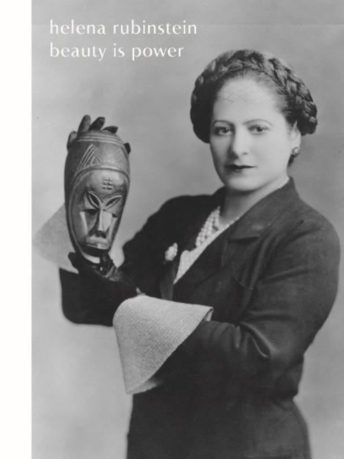 Helena Rubinstein holding one of her masks from the Ivory Coast, 1934. Photograph by George Maillard Kesslere. Helena Rubinstein Foundation Archives, Fashion Institute of Technology, SUNY, Gladys Marcus Library, Special Collections