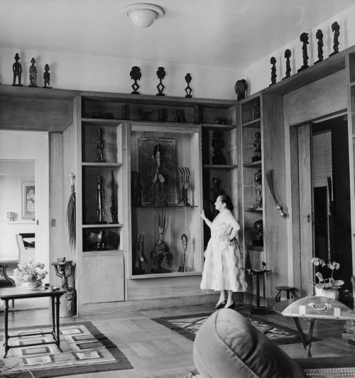 Helena Rubinstein in the library of her Paris apartment on the Ile St.-Louis, 1951. On display is a fraction of her extraordinary collection of African and Oceanic art. Helena Rubinstein Foundation Archives, Fashion Institute of Technology, SUNY, Gladys Marcus Library, Special Collections