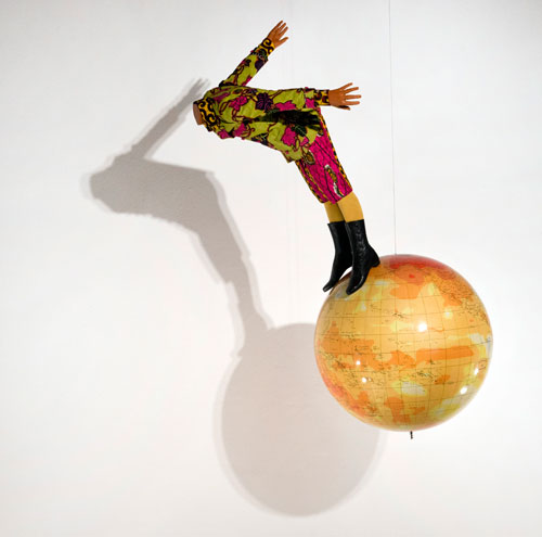 Yinka Shonibare MBE. Boy on Globe, 2008. Mannequin, Dutch wax printed cotton and globe, 180 × 125 × 100 cm. © Yinka Shonibare MBE. Courtesy the artist and Stephen Friedman and DACS.