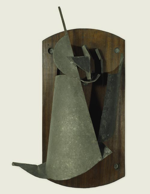 Vladimir Tatlin. <em>Counter-Relief </em>(<em>Material Selection</em>), 1916. Wood, iron, and zinc, 39 3/8 x 25 3/16 x 10 5/8 inches. The State Tretyakov Gallery, Moscow. Photo: © The State Tretyakov Gallery, Moscow.