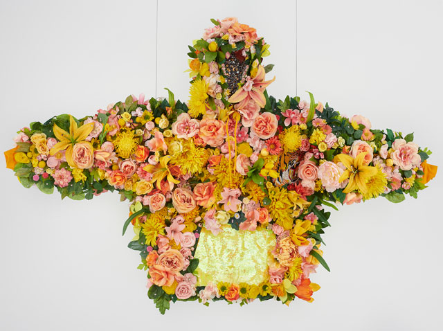 Devon Shimoyama, February II, 2019. Silk flowers, rhinestones, jewellery, sequins, and embroidered patch on cotton hoodie with steel armature, coated wire and fishing line, 45 x 72 x 12 in (114.3 x 182.9 x 30.5 cm). Image courtesy De Buck Gallery, New York.