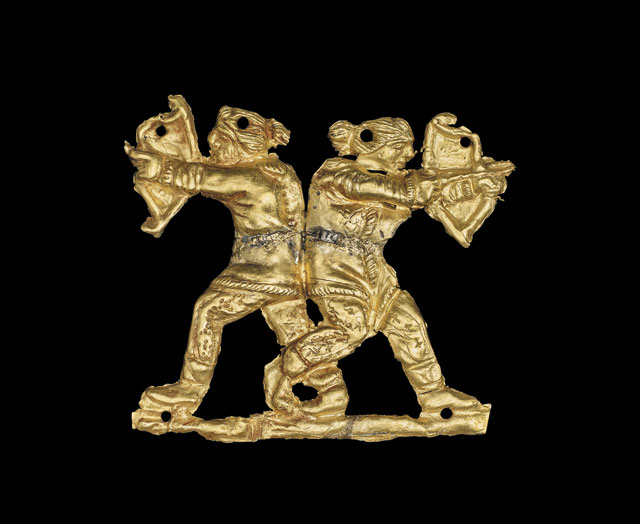 Applique archers. Gold applique showing two archers back to back, Kul Oba, 400BC - 350BC. © The Trustees of the British Museum.