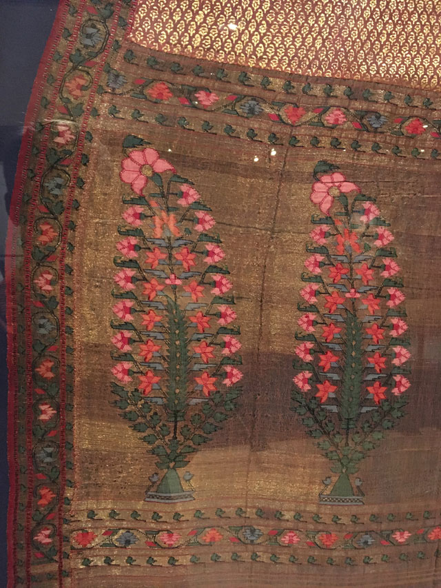 Kashmir shawl (detail), printed and brocaded gold and pink shawl, circa 1800. Block printing and weaving on silk. From The Whitworth's collection. Photograph: Veronica Simpson.