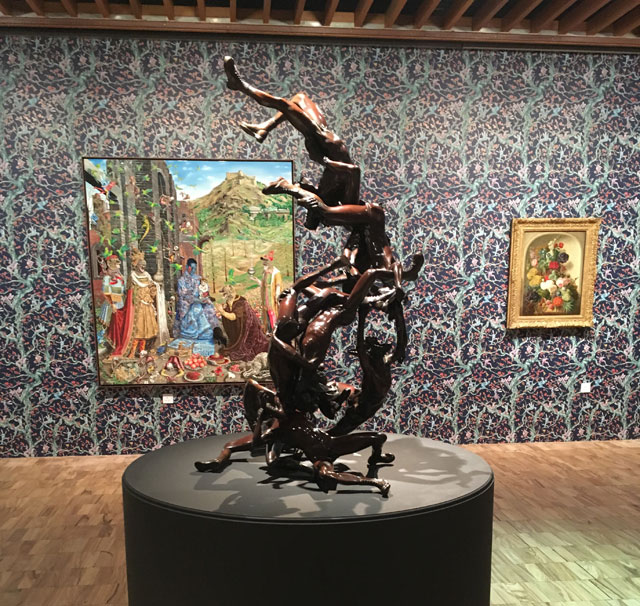 Nonet sculpture (Raqib Shaw) with The Adoration in the background. Installation view, the Whitworth Manchester, 2017. Photograph: Veronica Simpson.