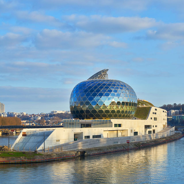 Shigeru Ban's design for La Seine Musical kept costs down with the same creamy concrete exterior and interior, but there is one extravagance: the acoustic Auditorium with its moveable sail. Photograph: Didier Boy de la Tour.