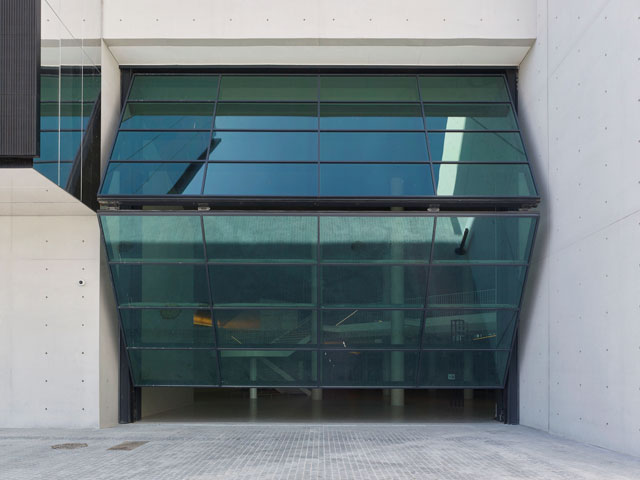 The bi-folding door at the main, south-facing entrance, is 12m wide and 10m high. It is intended to be open all day and evening, enticing visitors into the building even during performances. Photograph: Didier Boy de la Tour.
