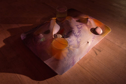 Samara Scott. Cabbage and clogs, 2014. Baking tray, tights, Sprite, cocktail glass, nail polish, food colouring, decorative sand. Courtesy of The Sunday Painter and the artist.