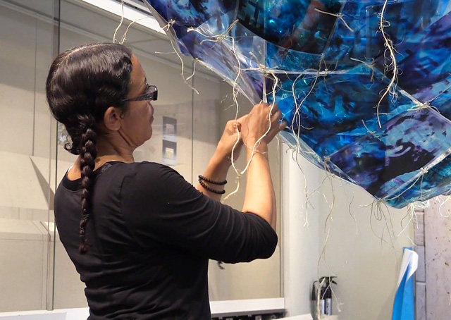 Toni Scott working on Slave Ship (Remembering the Forgotten), part of DNA – Bloodlines and the Family of Mankind, Arthur M Sackler Museum of Art and Archaeology at Peking University, 6 July 2015. Photo: Martin Kennedy.