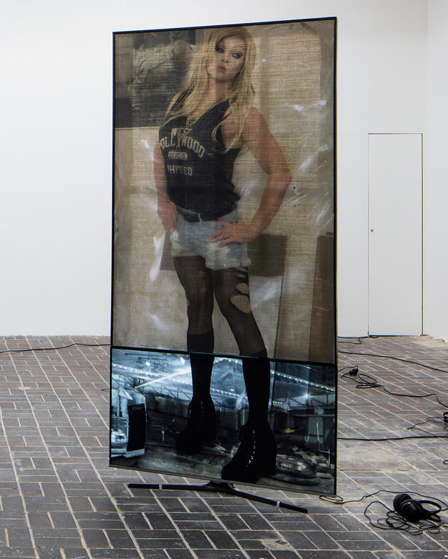 Philipp Timischl. Your Character Is So Hot – Hottest Character, 2014. UV print on epoxy resin on canvas, monitor, HD video, 160 x 105 x 15 cm. 