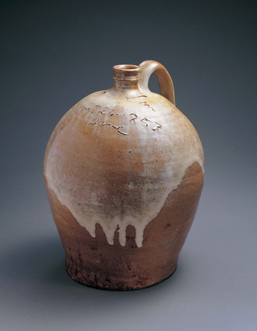 Jug. Dave Drake (c1800–c1870). Lewis J. Miles Pottery, Edgefield County, South Carolina, 1853. Alkaline-glazed stoneware, 14 1/2 x 12 x 11 1/2 in. Collection American Folk Art Museum, New York. Gift of Sally and Paul Hawkins. Photograph: John Parnell, New York.