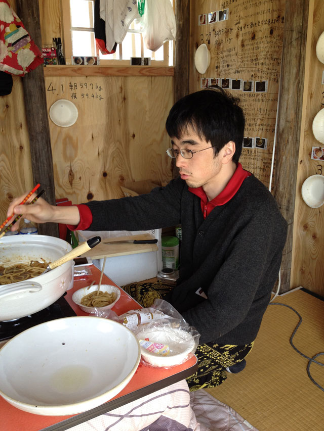 Satoshi Murakami. Every day, Murakami cooked food in his hut and invited curious local people to enter and participate in his daily ritual of eating.