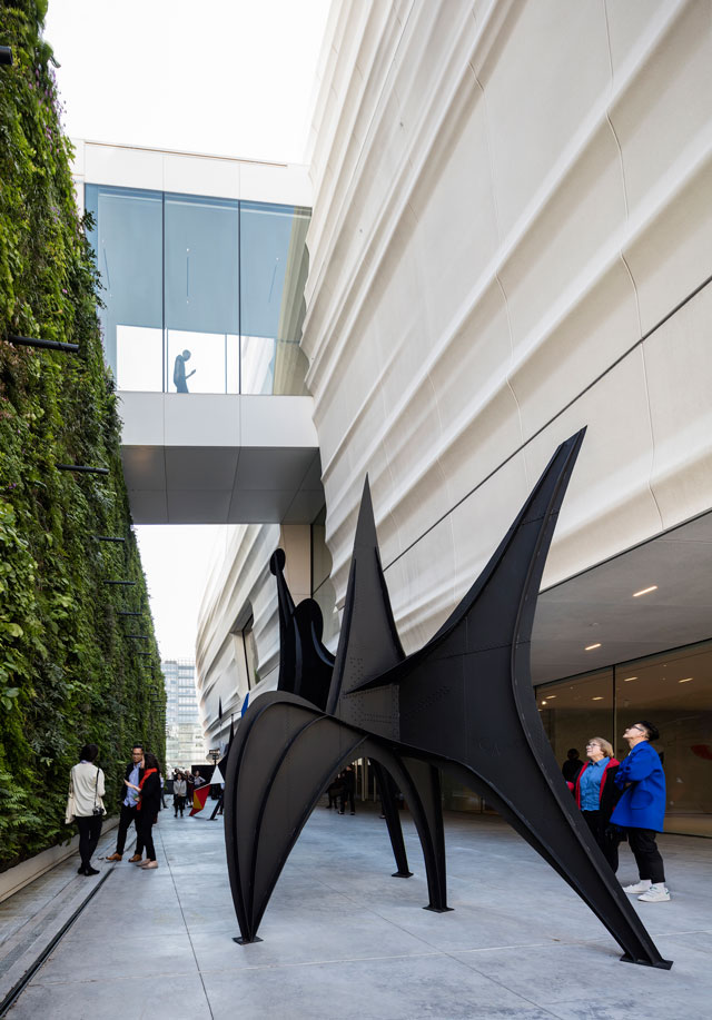Pat and Bill Wilson Sculpture Terrace featuring Alexander Calder's sculpture Maquette for Trois Disques (Three Disks), formerly Man (1967) and the living wall, designed by Habitat Horticulture. Photograph: © Henrik Kam, courtesy SFMOMA.