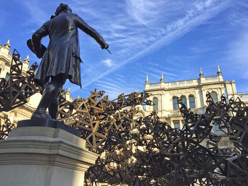 The statue of the RA's first president, Sir Joshua Reynolds, looks upon Conrad Shawcross' The Dappled Light of the Sun, 2015. Photograph: Martin Kennedy.