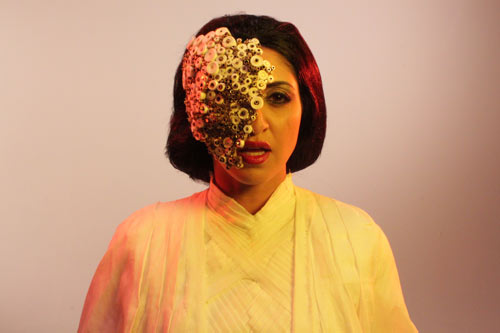 MASK (played by Houda        Echouafni) giving orders to      the aliens.