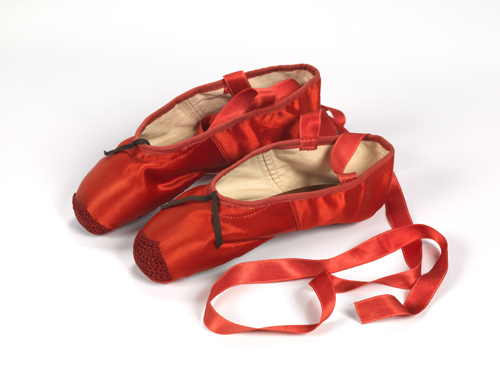 Freed of London (founded in 1929). Red ballet shoes made for Victoria Page (Moira Shearer) in The Red Shoes (1948). Silk satin, braid and leather, England, 1948. Photograph reproduced with the kind permission of Northampton Museums and Art Gallery.
