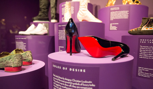 Christian Louboutin 'Pigalle' pump. Installation view of Shoes: Pleasure and Pain. © Victoria and Albert Museum, London.