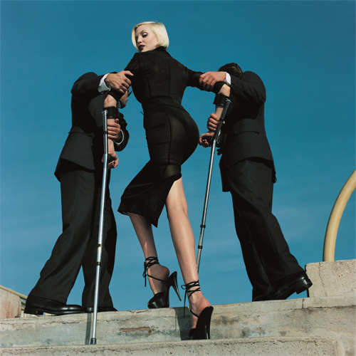 Dolce & Gabbana suit, Summer 1995. High & Mighty shoot, American Vogue (model: Nadja Auermann), February 1995. © Estate of Helmut Newton / Maconochie Photography.