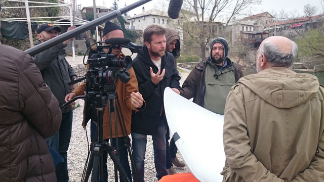 Tim Slade (centre) with his crew during filming of the Mostar bridge sequence.