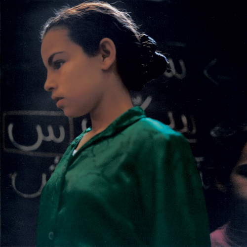Yto Barrada.<em> Meriem - A spelling class at the Darna day centre for street children, Tangier 1999</em>, from the series <em>A Life Full of Holes: The Strait Project</em>, 1998-2004. C-print © Yto Barrada. Courtesy of Galerie Polaris and the artist.