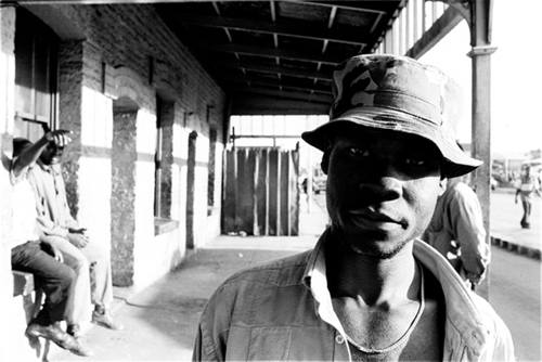 Luis Basto. <em>Bus Stop, Old Harare</em>, 2001. Fibre-based photographic print, 15.6 x 19.5 in. (40 x 50 cm) © Luis Basto. Courtesy of the artist.