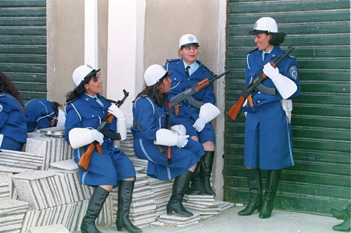 Zohra Bensemra. <em>Law-and-order enforcement officers at the Ain Benian police school in Algiers, on the day of graduation of the new self-defence and close combat squad, January 27, 1999</em>. C-print, 11 x 14 in. (27.9 x 35.6 cm) © Zohra Bensemra. Courtesy of the artist.