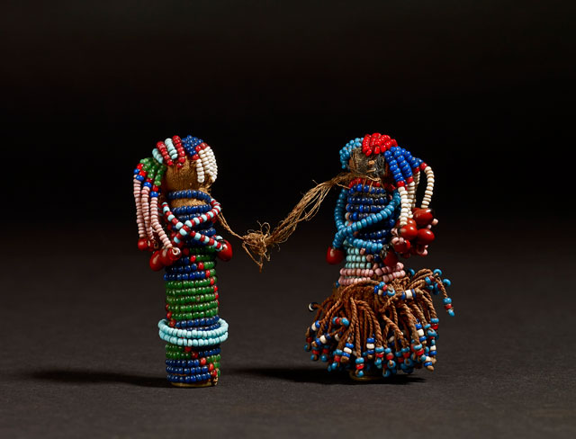 Pair of Sotho Gun Cartridge Dolls. Glass, brass and leather, South Africa, late 19th century. © The Trustees of the British Museum.