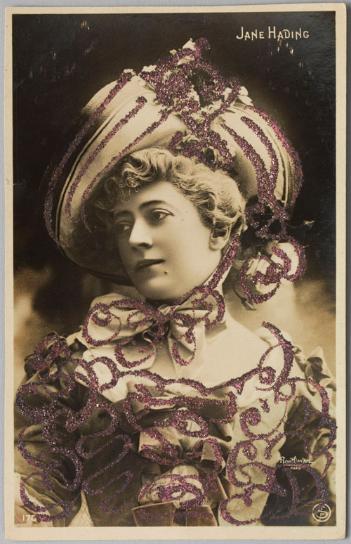 Reutlinger Studio (French, 1850-1937). Postcard of Jane Hading in La Pompadour, c1901. Hand-colored photograph with glitter. Private collection. Photograph: Bruce White.
