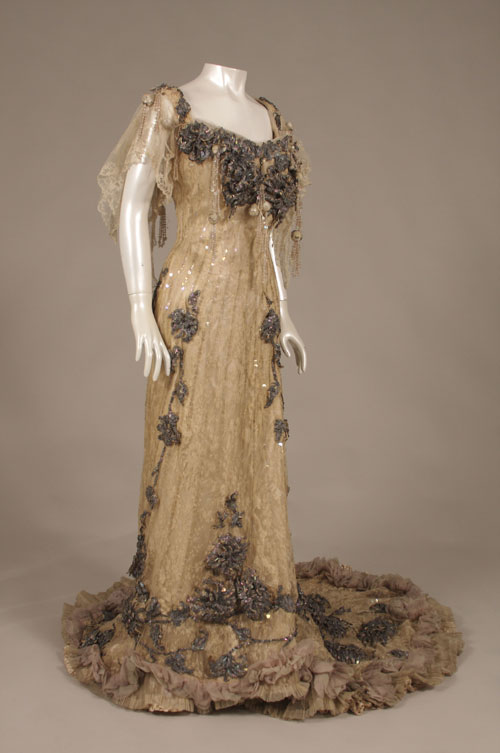 Charles Poynter (English, 1853–1929) for the House of Redfern (English, 1881–1929). Evening gown, c1904. Silk taffeta, silk satin, silk chiffon); lace; iridescent sequins and beads. Museum of the City of New York, Gift of Mrs. Ruth Fahnestock and Mrs. Faith Fahnestock Paine, 1941. Photograph: Bruce White.