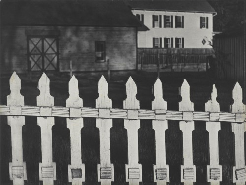 Paul Strand. White Fence, Port Kent, New York, 1916 (negative); 1945 (print). Gelatin silver print, Image and sheet: 9 5/8 × 12 13/16 in (24.5 × 32.5 cm), Philadelphia Museum of Art, The Paul Strand Retrospective Collection, 1915-1975, gift of the estate of Paul Strand, 1980. © Paul Strand Archive/Aperture Foundation.