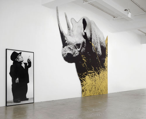 John Baldessari. Dwarf and Rhinoceros (With Large Black Shape), 1989/2013. Archival inkjet prints mounted on Lexam with inset aluminum frame, latex paint, archival inkjet print mounted on Plexiglas, dimensions variable.