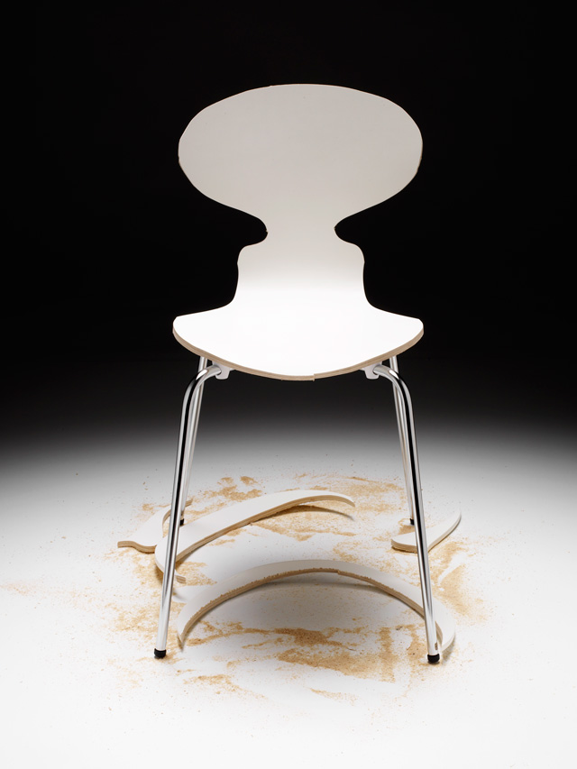 Superflex. Copy Right, 2006. White wooden chair, sawdust, wood cut-outs, white painted wooden platform, installation manual, 85 x 90 x 90 cm. Photograph: Egon Gade.