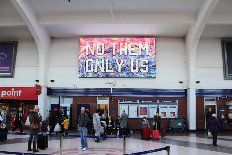 Mark Titchner. No them only us, 2016. Animation. Installation view, Blackpool North Station, 2018.