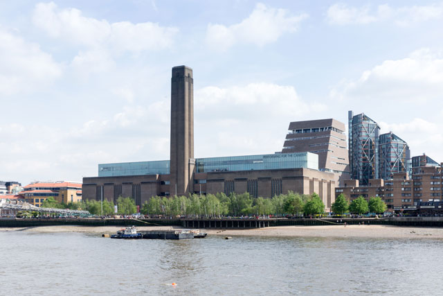 View across the River Thames to Tate Modern Boiler House and Switch House, with adjacent Rogers Stirk Harbour + Partners-designed apartments, Neo Bankside.