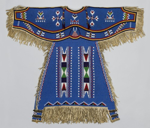 Woman's Dress, c1900. Dakota (Eastern Sioux), Yanktonai or Lakota (Teton Sioux) artist, Fort Peck Reservation (Montana) Native tanned leather, glass, brass and steel-cut beads, metal cones, horsehair. 48 x 39 in (121.9 x 99.1 cm). Washington (District of Columbia), Smithsonian Institution, National Museum of Natural History, Department of Anthropology. Photograph: National Museum of Natural History, Smithsonian Institution, Department of Anthropology. (Cat.109).
