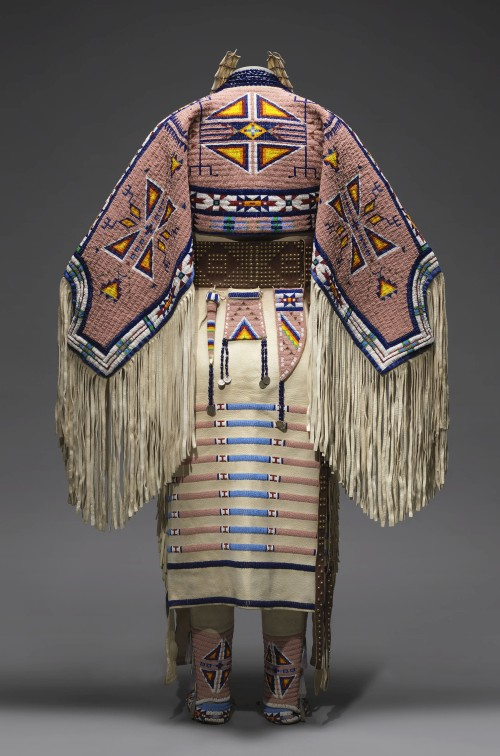 Woman's Dress and Accessories, 2005. Jodi Gillette (1959-), Hunkpapa Lakota (Teton Sioux), North Dakota. Native tanned and commercial leather, glass and metal beads, cotton cloth, silk, dentalium shell, metal cones, horsehair, plastic, hair pipes, brass bells, porcupine quills, brass tacks, brass and metal studs, silver cones. 54 × 60 in (137.2 × 152.4 cm). United States, Courtesy of Jodi Gillette. Photograph: Joshua Ferdinand, courtesy of Jodi Gillette. (Cat.134).
