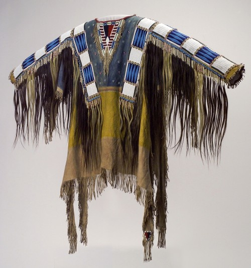 Man's Shirt, 1865. Oglala Lakota (Teton Sioux) artists, South Dakota. Native tanned leather, pigment, human hair, horsehair, glass beads, porcupine quills, 58 x 42 ½ in (147.3 x 108 cm). Cody (Wyoming), Buffalo Bill Center of the West, Collection Adolf Spohr, gift of Larry Sheerin. Photograph: Buffalo Bill Center of the West. (Cat.72).